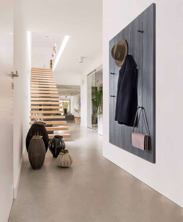 The Pin Hang wall-mounted chair system by Salice